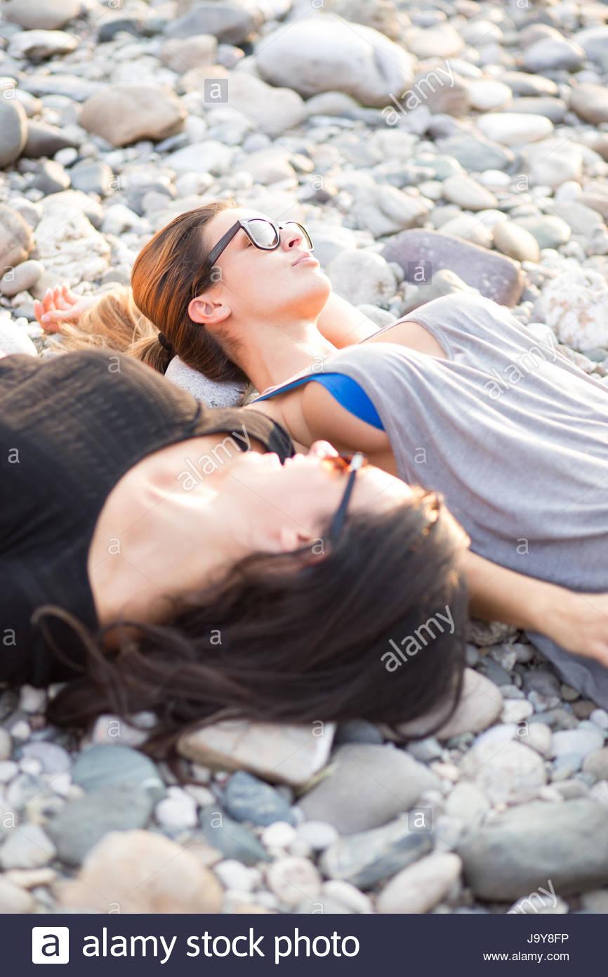 Young women relaxing on beach - Stock Image