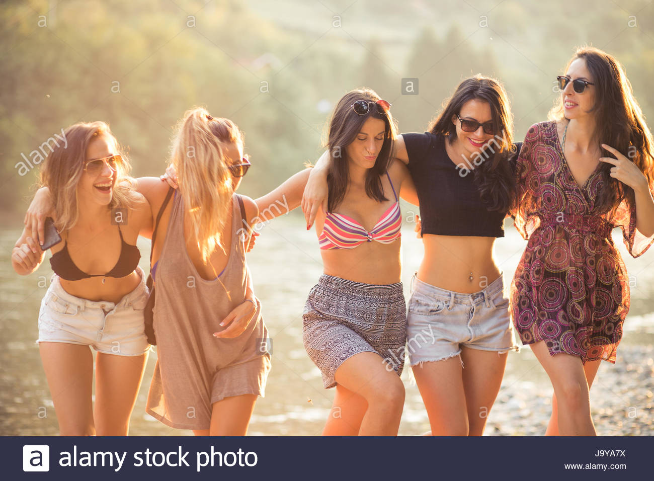 Young women enjoy on beach on summer day - Stock Image