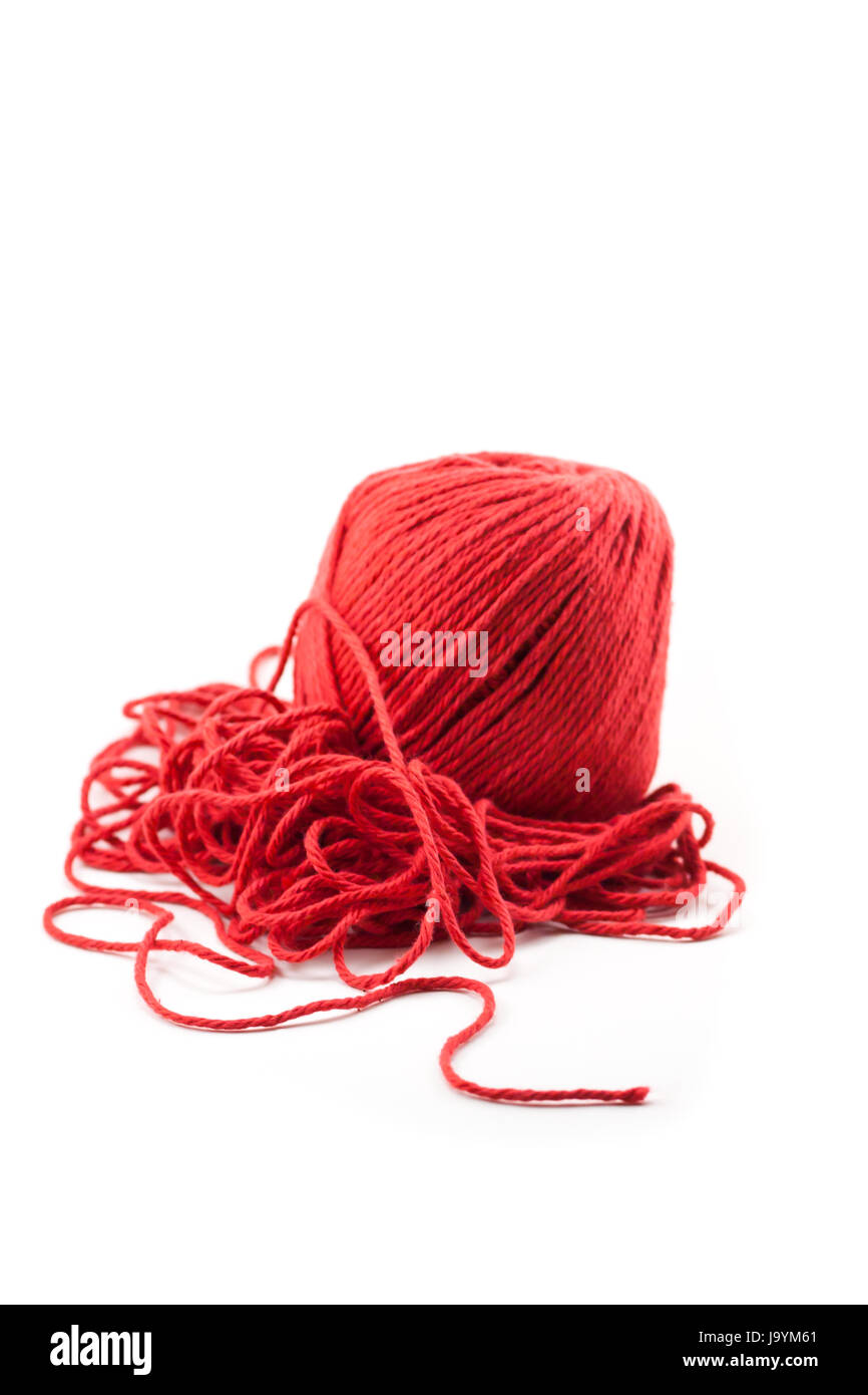 Tangled pile of red yarn with a single piece leading out, isolated on white. - Stock Image
