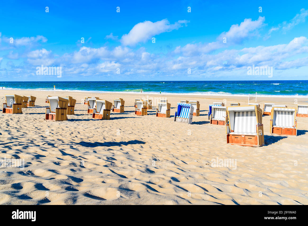 Wicker chairs on white sand beach in Wenningstedt village on Sylt island, North Sea, Germany Stock Photo