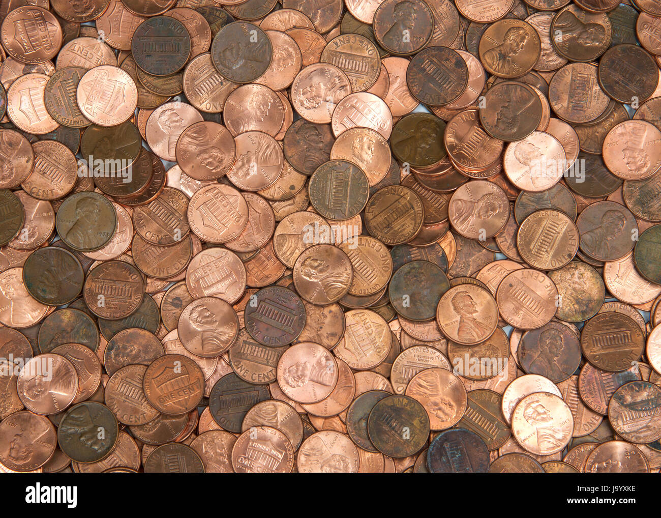 Flat view pennies. United States currency penny, many old new dirty clean viewed from directly above. The penny - Stock Image