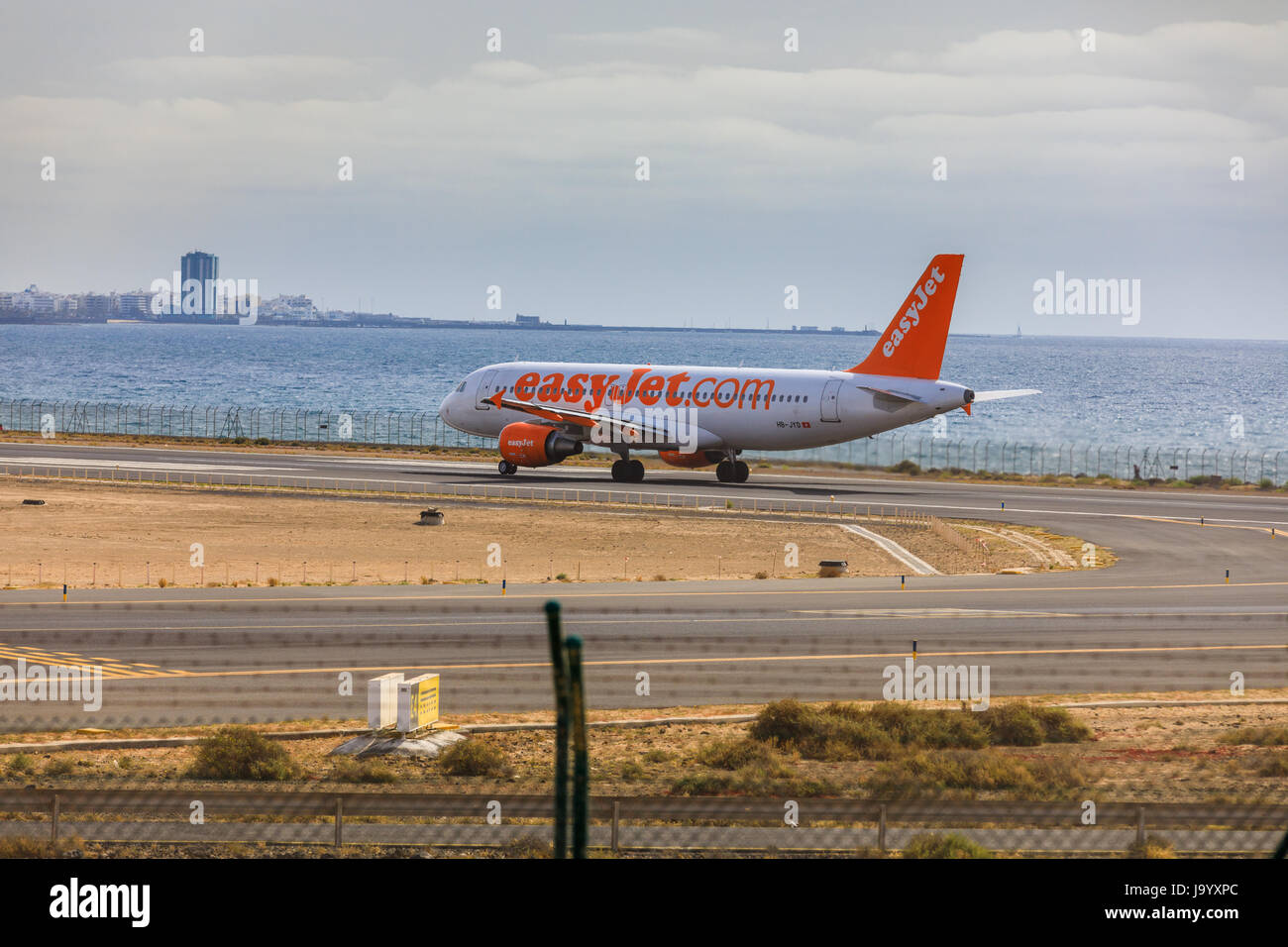 ARECIFE, SPAIN - APRIL, 15 2017: AirBus A320 of easyjet.com ready to take off at Lanzarote Airport - Stock Image