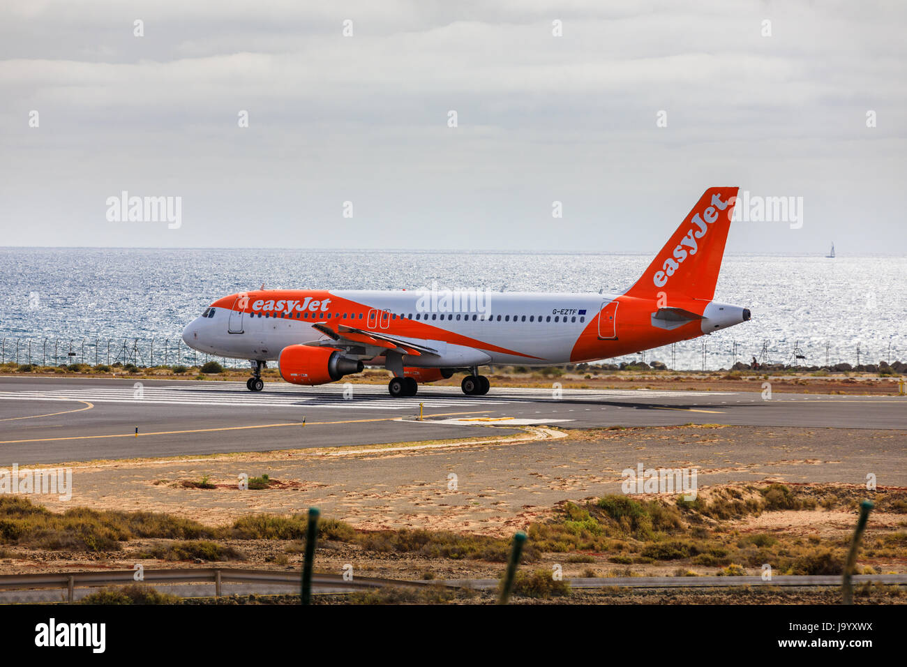 ARECIFE, SPAIN - APRIL, 15 2017: AirBus A319-100 of easyjet ready to take off at Lanzarote Airport - Stock Image