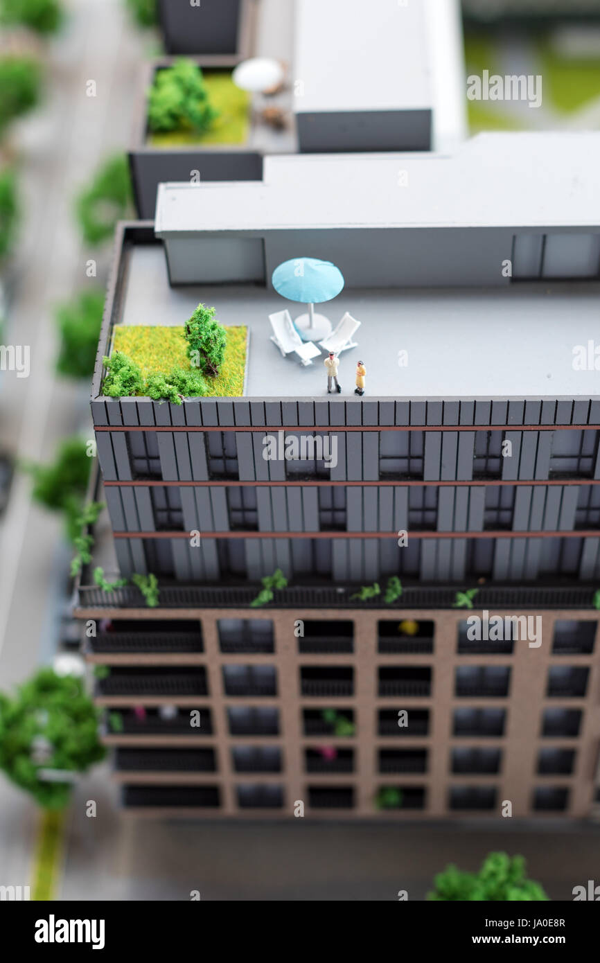 Miniature model, miniature toy buildings, cars and people. City maquette. Stock Photo
