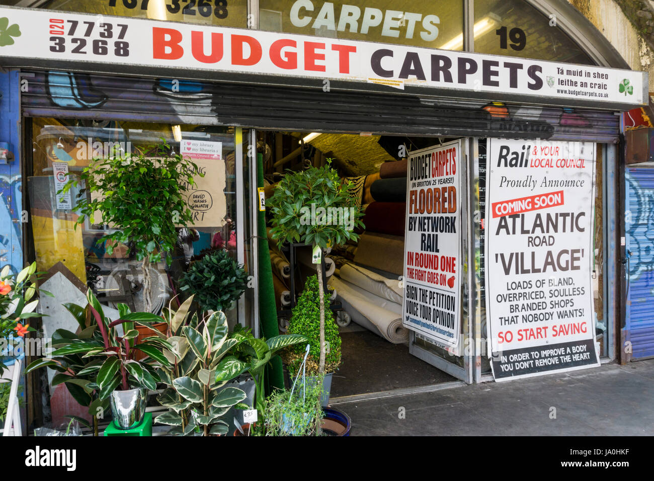 A sign on a carpet shop in a Brixton railway arch protesting at the gentrification of Brixton by Lambeth Council - Stock Image
