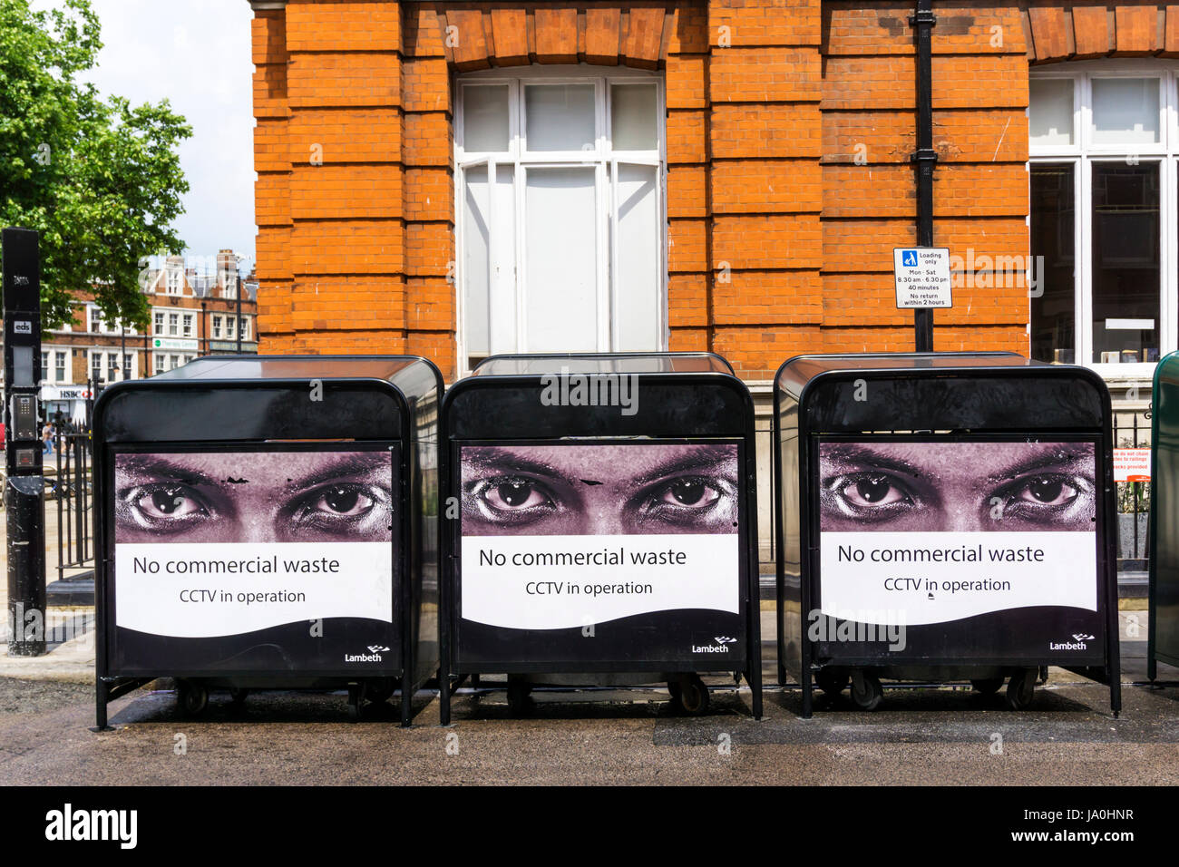 Signs warn against putting commercial waste in public rubbish bins. - Stock Image