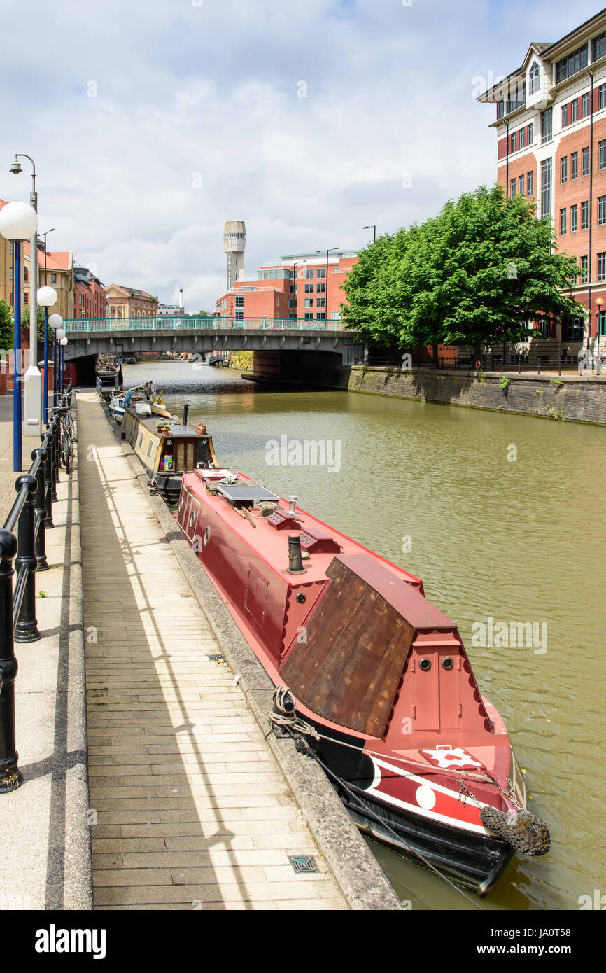 Bristol, England - July 17, 2016: Narrowboats docked at Temple Quay in Bristol's Floating Harbour. - Stock Image