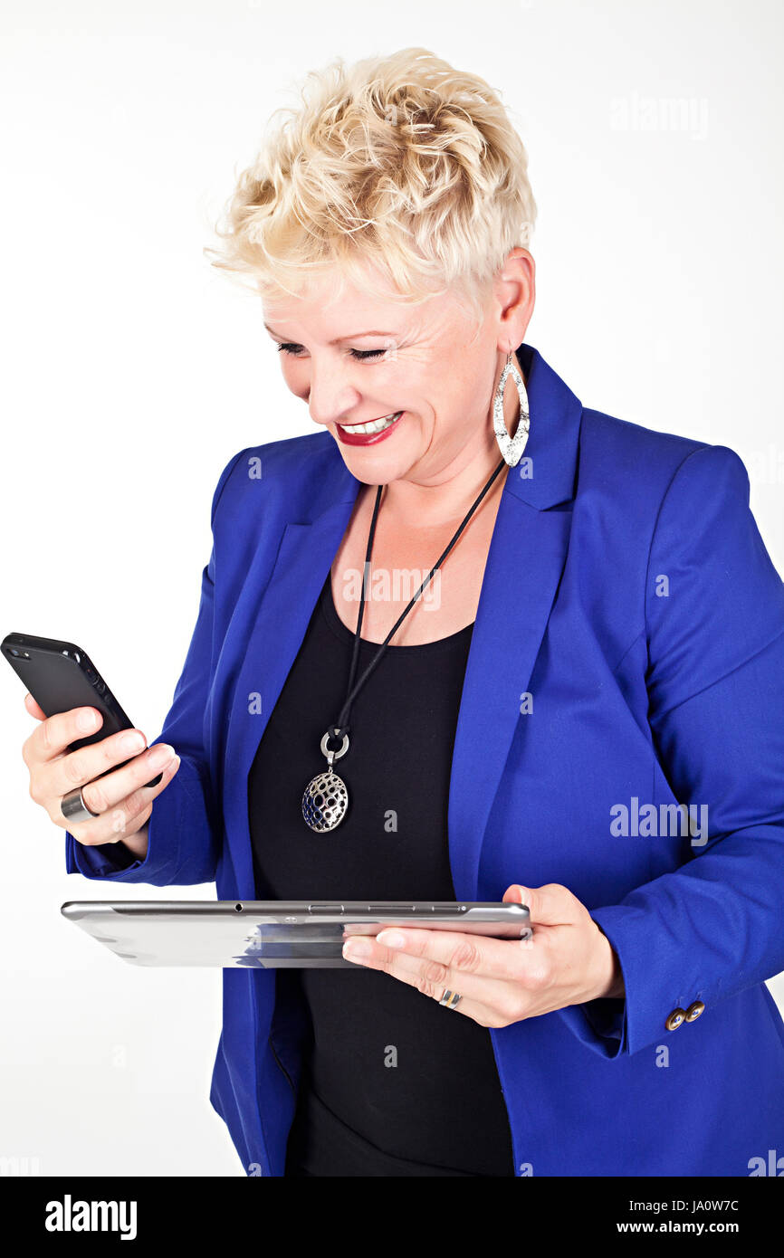middelaged business woman in jacket talking on the phone Stock Photo
