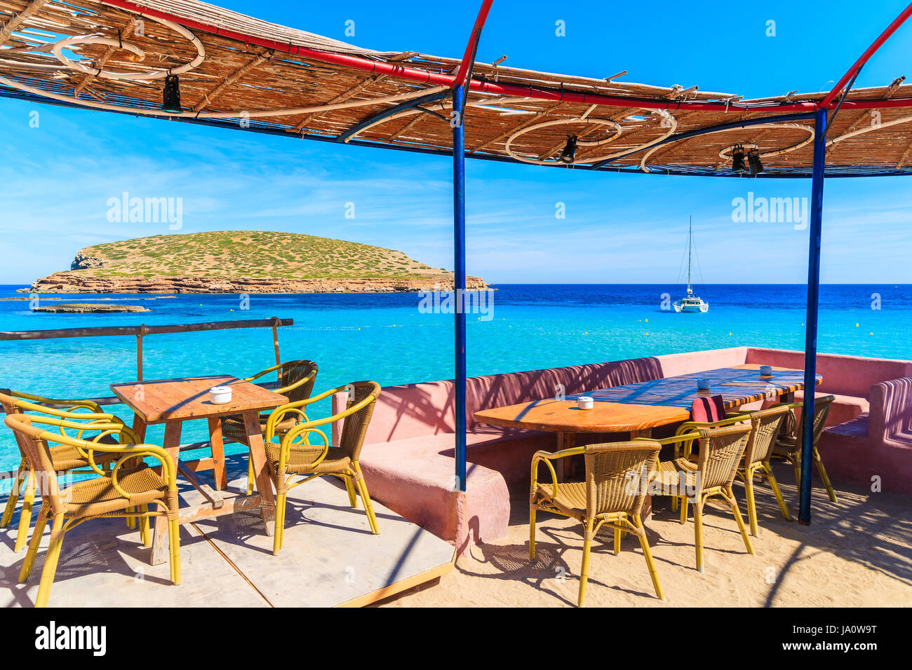 IBIZA ISLAND, SPAIN - MAY 17, 2017: Coastal bar with beautiful sea view on Cala Comte beach, Ibiza island, Spain. - Stock Image