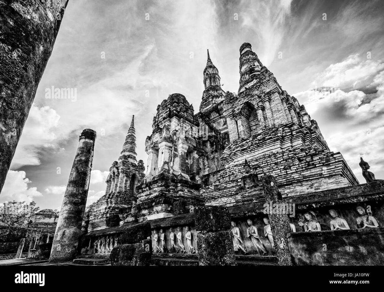 Black and white two tone vintage style, Ancient chapel among the ruins under the bright sky at Wat Maha That temple - Stock Image