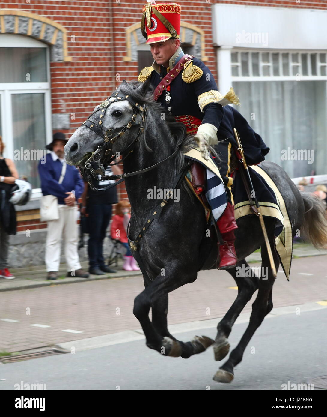 Ligny, Belgium. 3rd June, 2017. A participant rides a horse during the re-enactment of the Battle of Ligny, in Ligny, - Stock Image