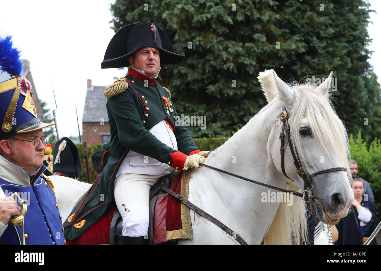 Ligny, Belgium. 3rd June, 2017. A man enacting Napoleon rides a horse during the re-enactment of the Battle of Ligny, - Stock Image