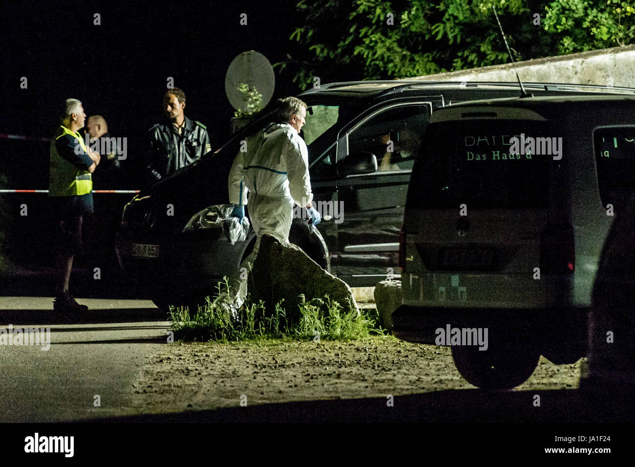 Arnschwang, Germany. 3rd June, 2017. dpatop - Police officers stand on the premises of an asylum home near Arnschwang, - Stock Image