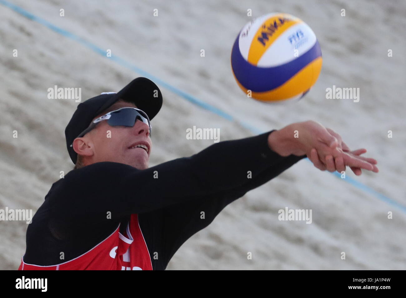 MOSCOW, RUSSIA – JUNE 4, 2017: Nikolai Lyamin of Russia in action during the final match against US Phil Dalhausser - Stock Image