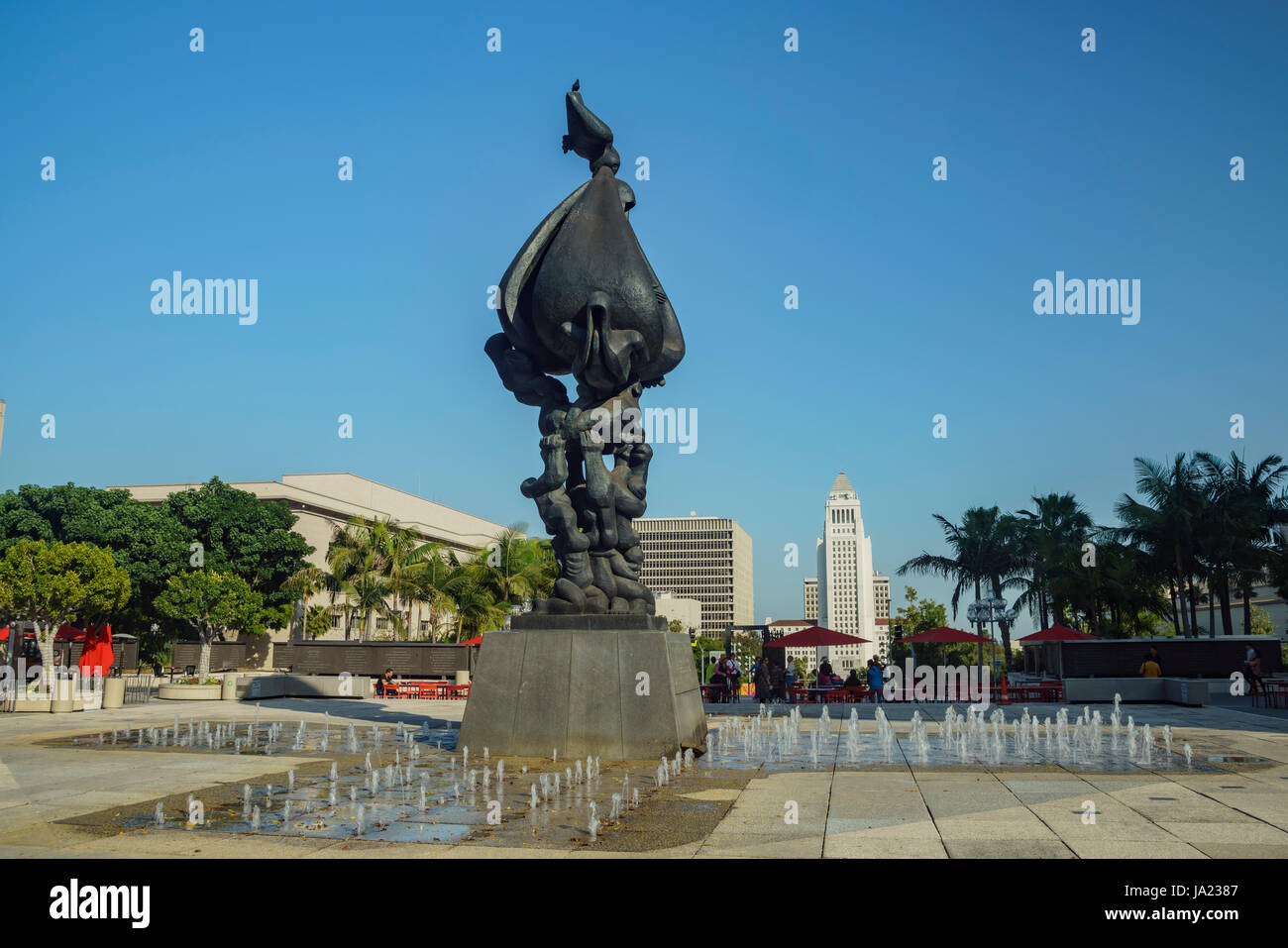 Los Angeles, APR 11: Big peace on earth statue and fountain with city hall behind on APR 11, 2017 at Los Angeles - Stock Image