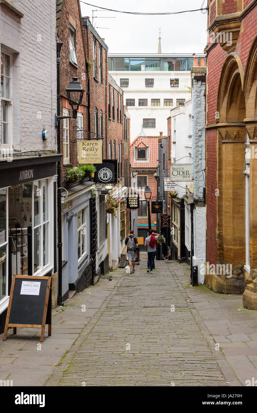 Bristol, England, UK - July 17, 2016: Small shops on the narrow Christmas Steps, an alleyway in central Bristol. - Stock Image