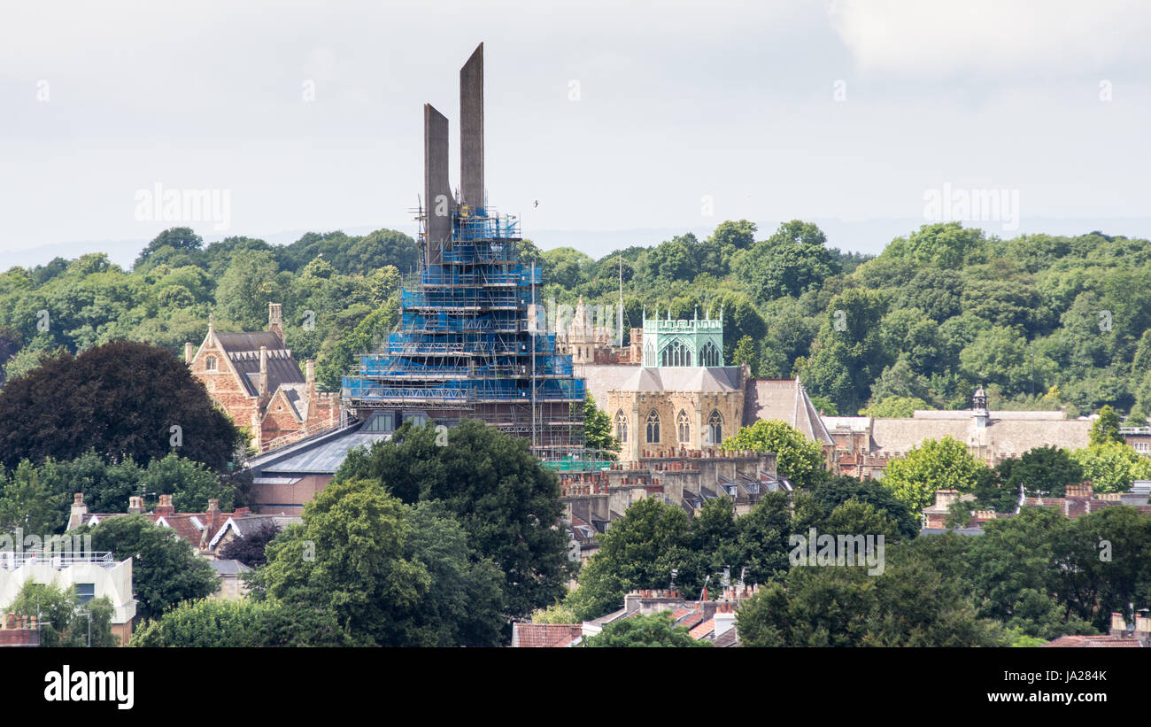 Bristol, England - July 17, 2016: The scaffolding-covered concrete spire of Clifton Cathedral, with Clifton College - Stock Image