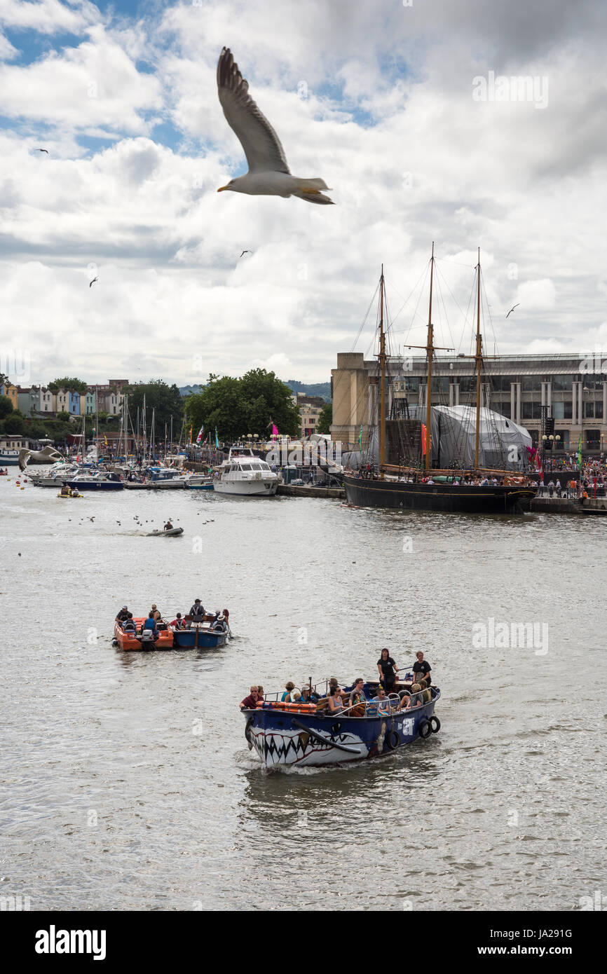 Bristol, England - July 17, 2016: Seagulls fly over small ferryboats transporting passengers around Bristol Harbour - Stock Image