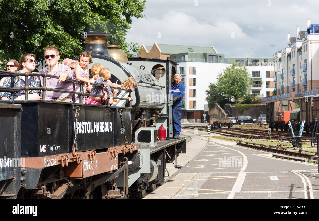 Bristol, England - July 17, 2016: People ride on a train driven by a steam shunting engine on the Bristol Harbour - Stock Image