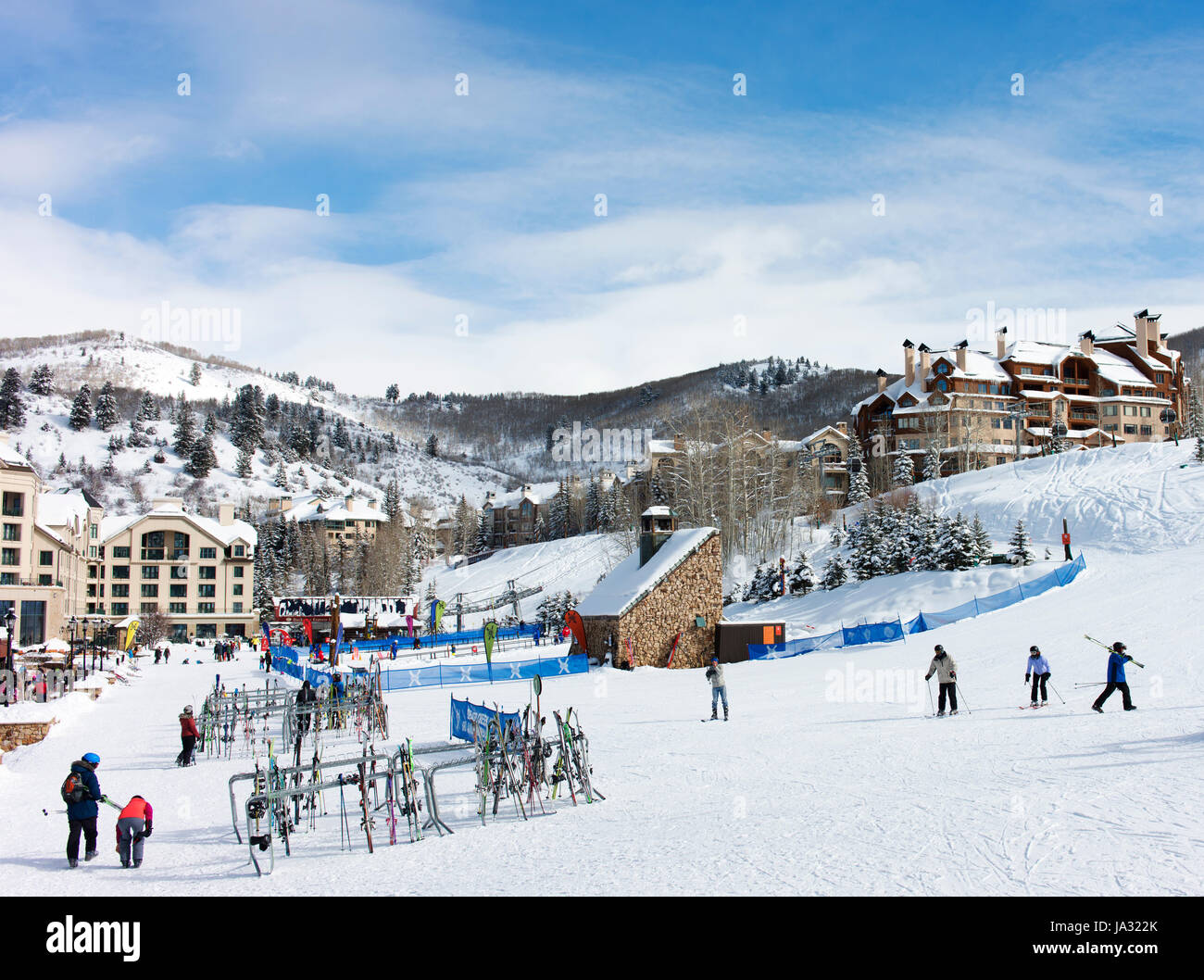 Skiers and accommodation buildings at Beaver Creek, a ski resort near Avon, Colorado. - Stock Image
