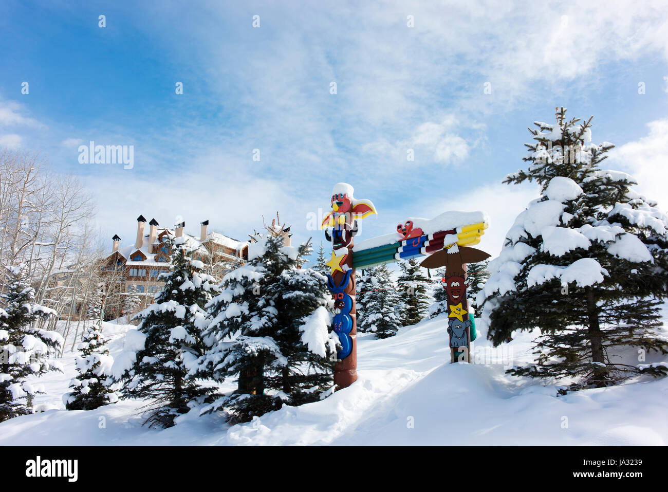Totem poles and trees with fresh snow at Beaver Creek, a ski resort near Avon, Colorado. - Stock Image