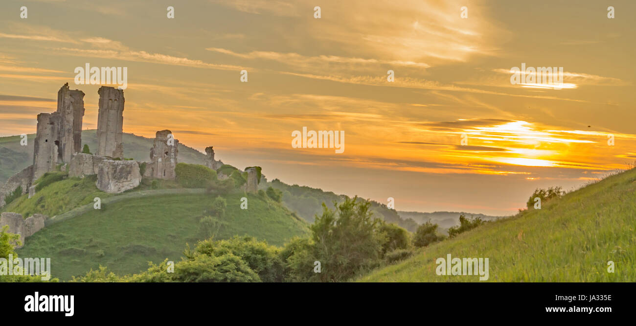 Corfe Castle,Dorset,England on a golden Sunset - Stock Image