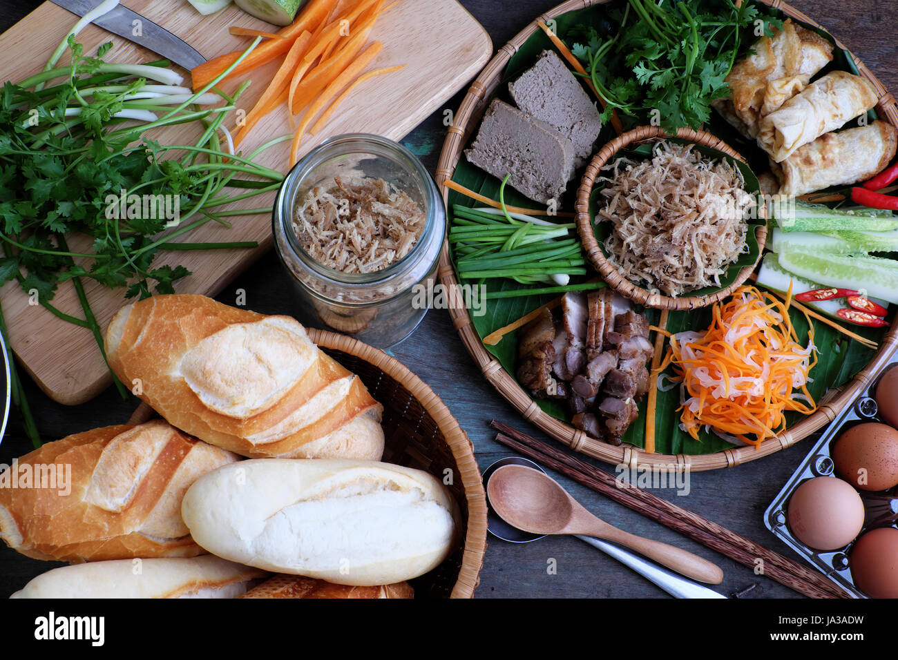 Famous Vietnamese food is banh mi thit, popular street food from bread stuffed with raw material: pork, ham, pate, - Stock Image