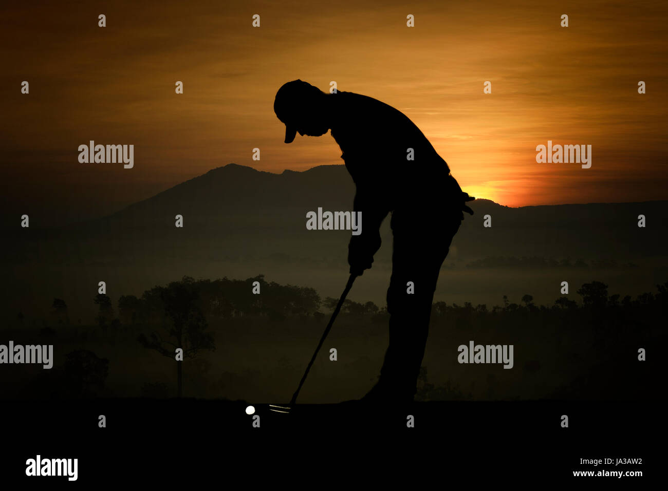silhouette of golfers hit sweeping and keep golf course in the summer for relax time - Stock Image