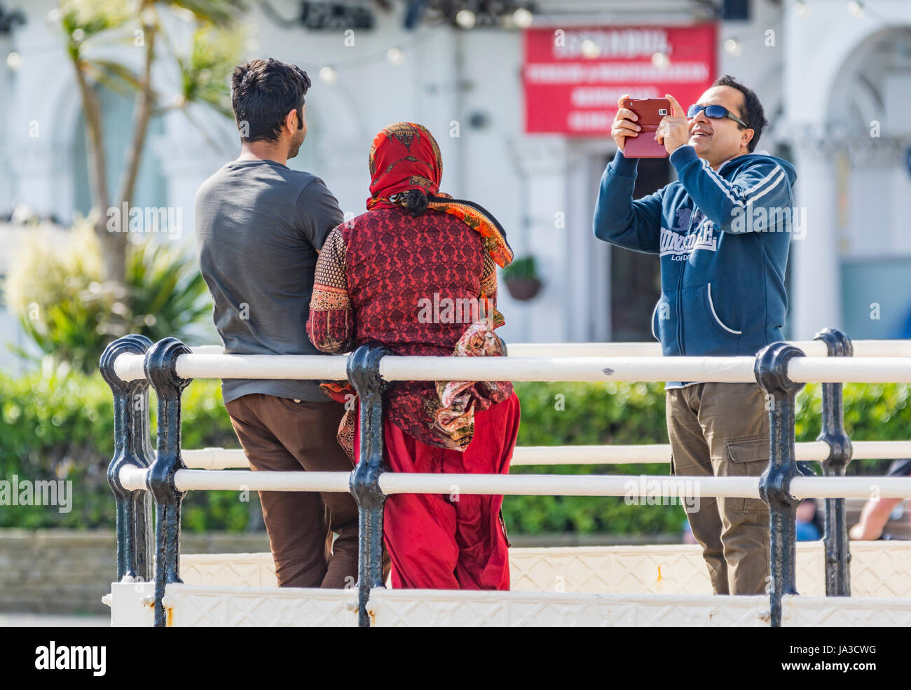Asian photos taking a photos of each other. - Stock Image
