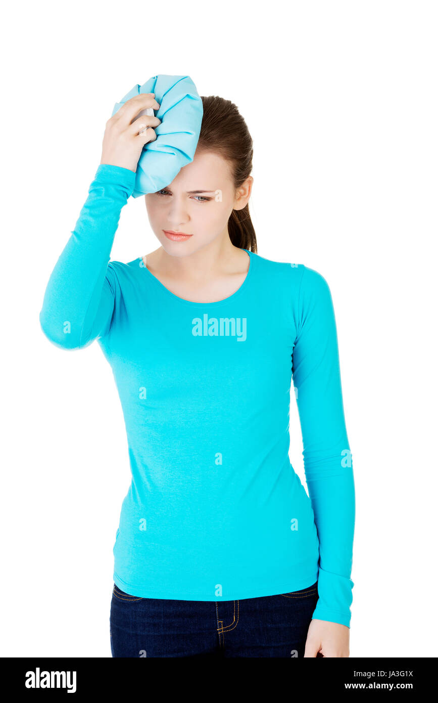 Woman with ice bag for headaches and migraines , isolated on white - Stock Image