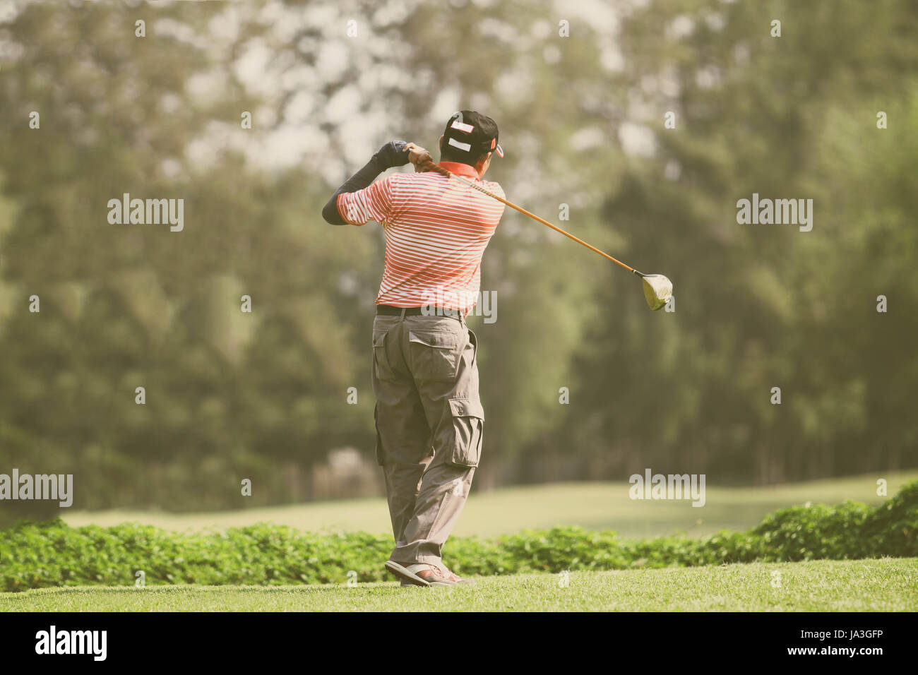 golfers hit sweeping and keep golf course in the summer  for relax time - Stock Image