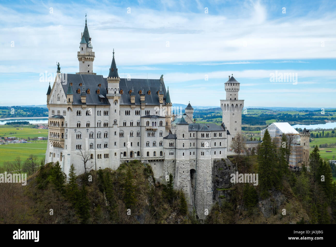 Neuschwanstein castle, view from Marienbrucke bridge, the famous viewpoint in Fussen, Germany - Stock Image