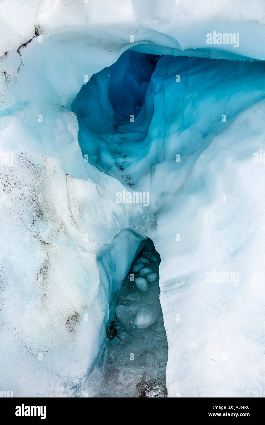 Ice caves in the surface of a glacier, Fox Glacier, South Island, New Zealand - Stock Image