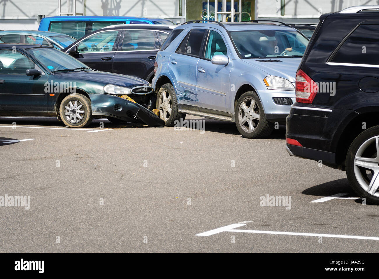 Car accident in the parking lot. Inattention behind the wheel concept - Stock Image