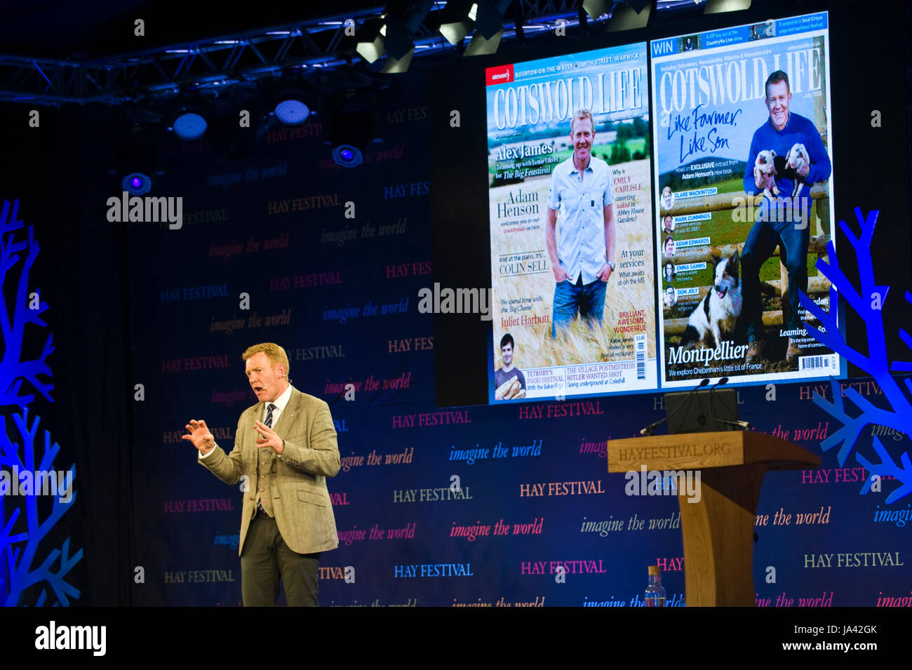 Adam Henson farmer & Countryfile presenter speaking about his life & career on stage at Hay Festival 2017 - Stock Image