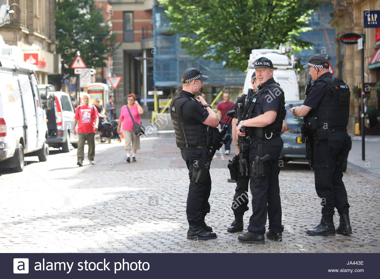 Armed policemen on the streets of Manchester, close to St Ann's square, as the terror threat intensifies. - Stock Image
