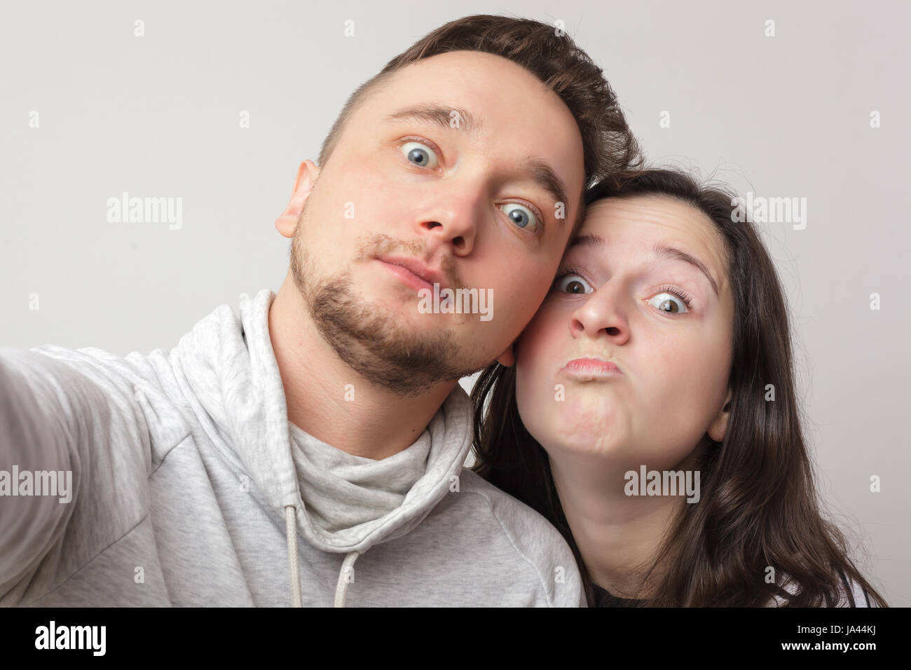 Young  loving couple makes selfie. Snapshot for memory - Stock Image
