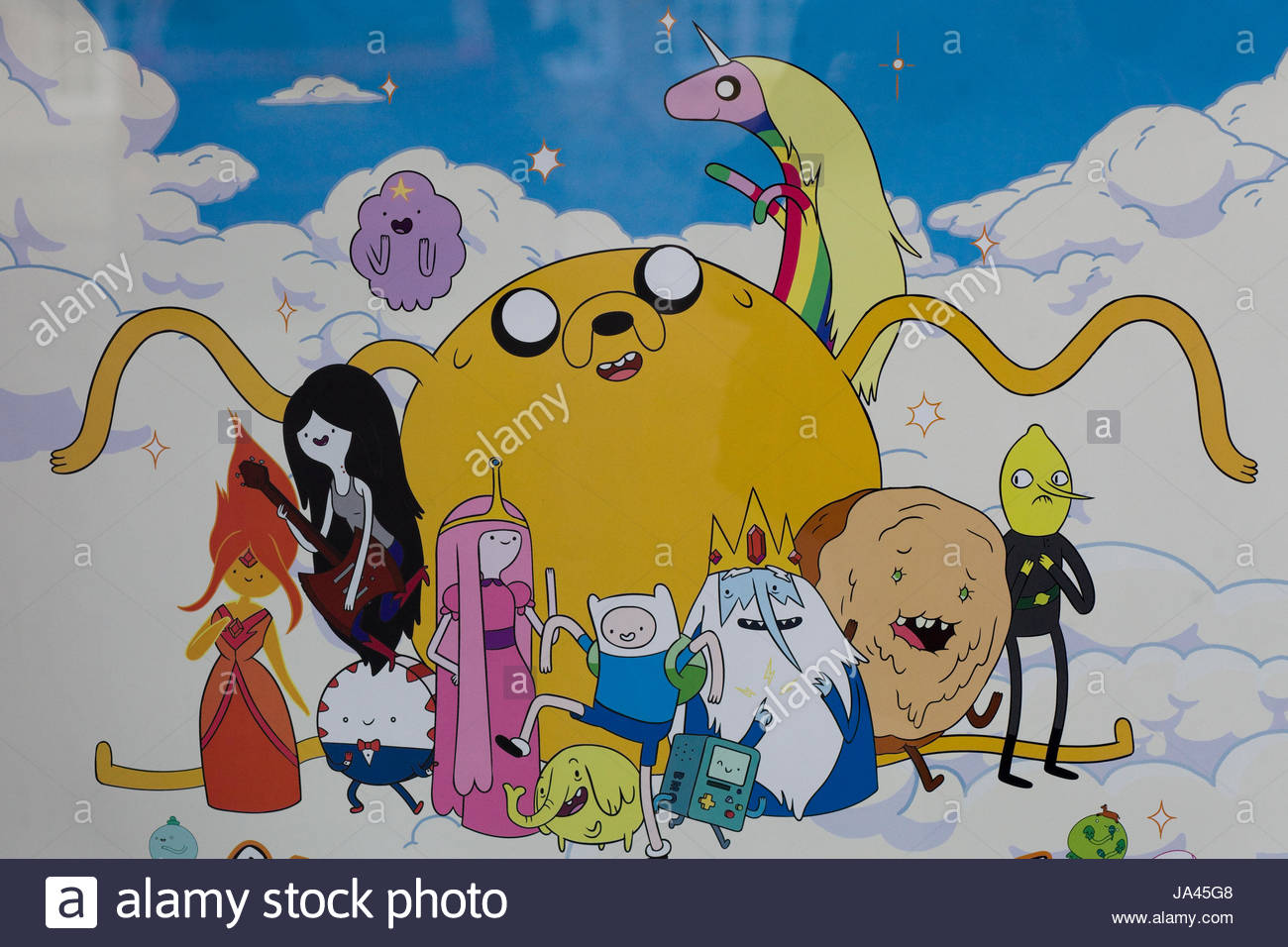Shop window displaying Adventure Time poster - Stock Image