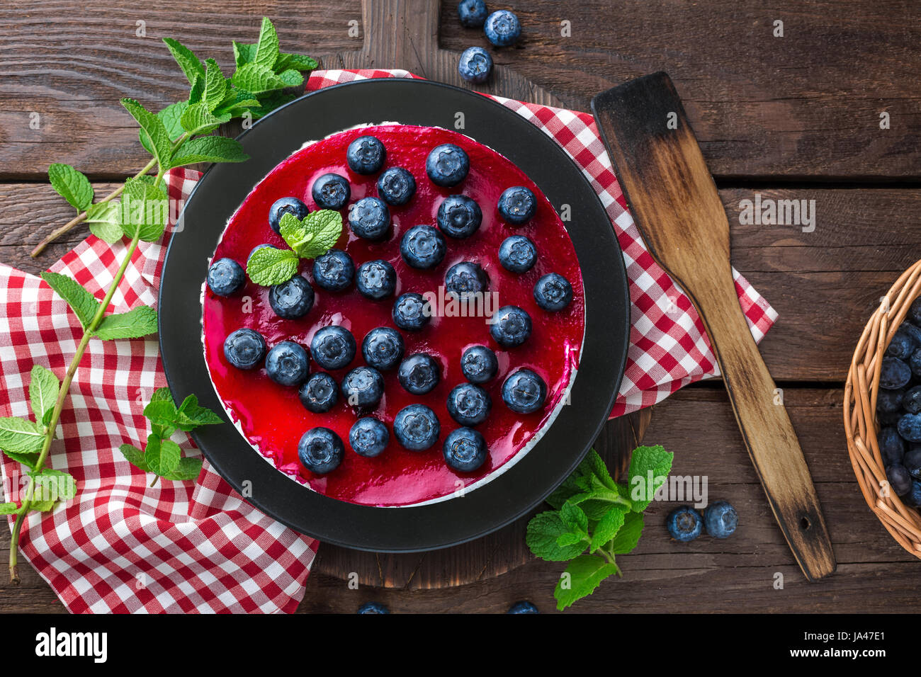 Blueberry cake with fresh berries and marmalade, cheesecake - Stock Image