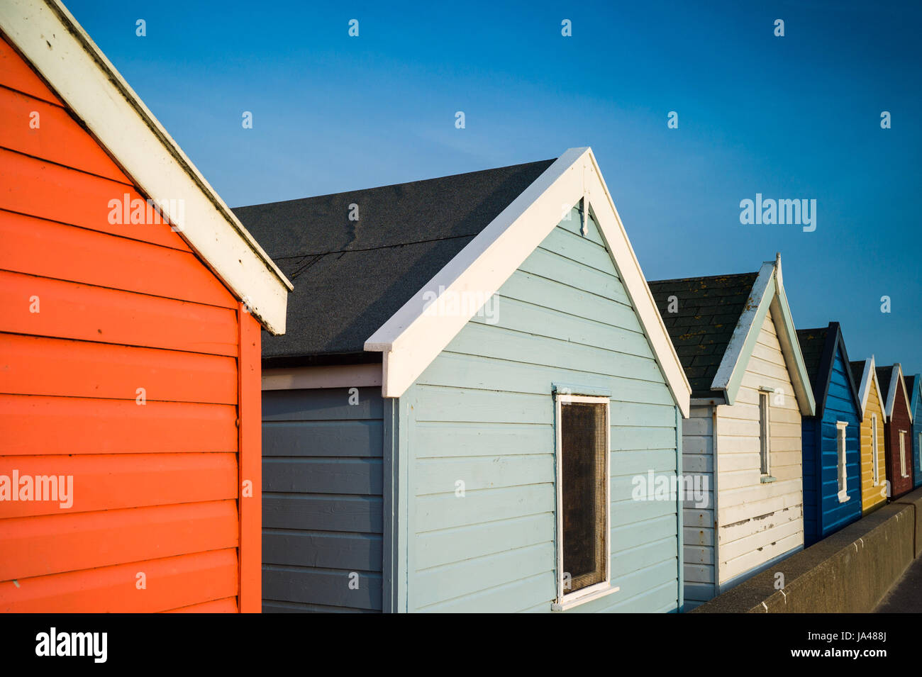 Brightly painted Beach Huts in the small seaside resort of Southwold in Suffolk, UK. - Stock Image