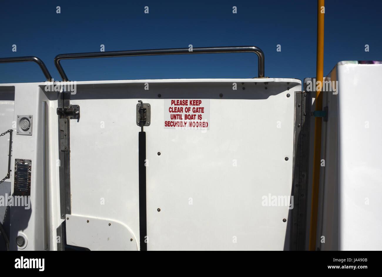 Brisbane, Australia: 'Please Keep Clear of Gate' sign on CityCat passenger ferry - Stock Image