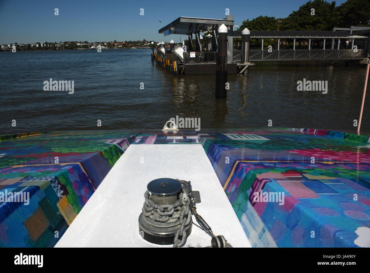Brisbane, Australia: CityCat ferry approaches Teneriffe wharf on the Brisbane River - Stock Image