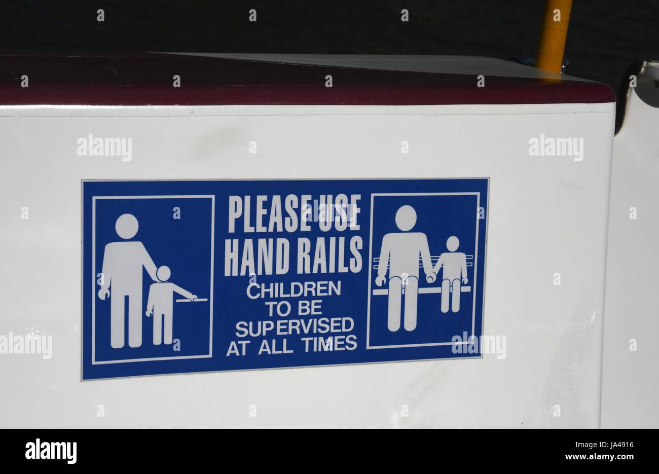 Brisbane, Australia: 'Please Use Hand Rails' sign on CityCat passenger ferry - Stock Image