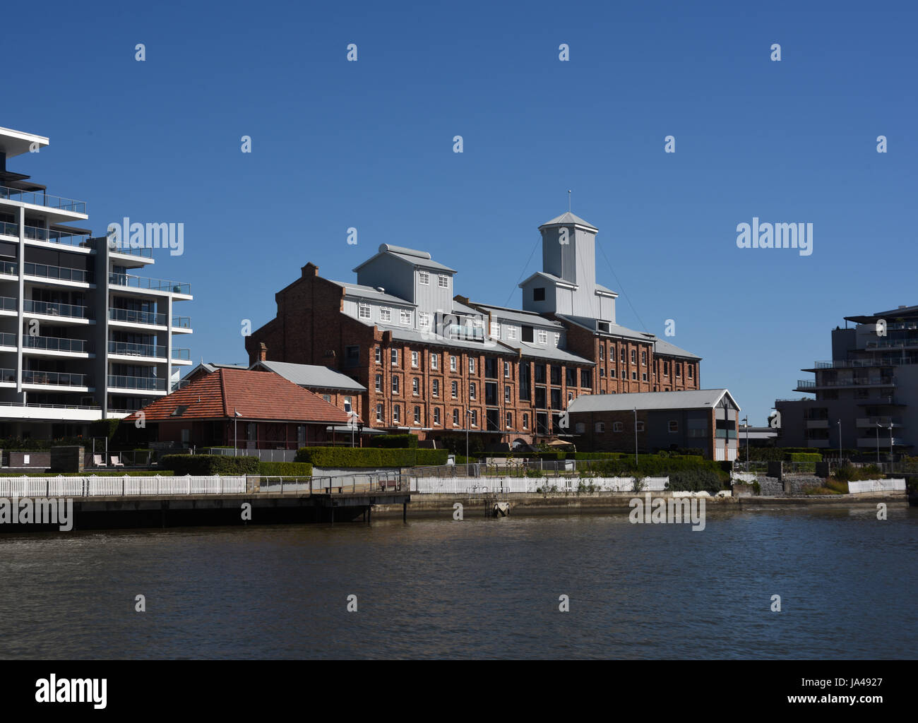 Brisbane, Australia: Former Colonial Sugar refinery at New Farm, converted to riverside apartments - Stock Image