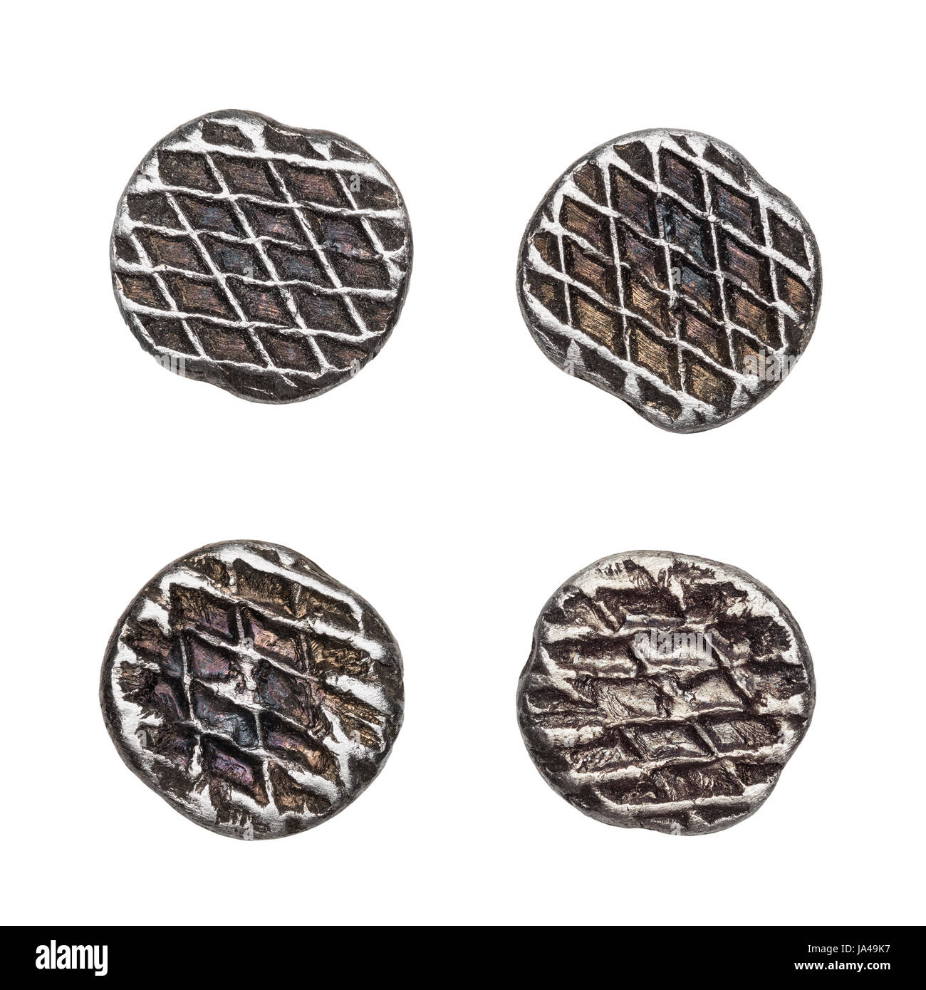 Nail heads made of steel, isolated on white. - Stock Image