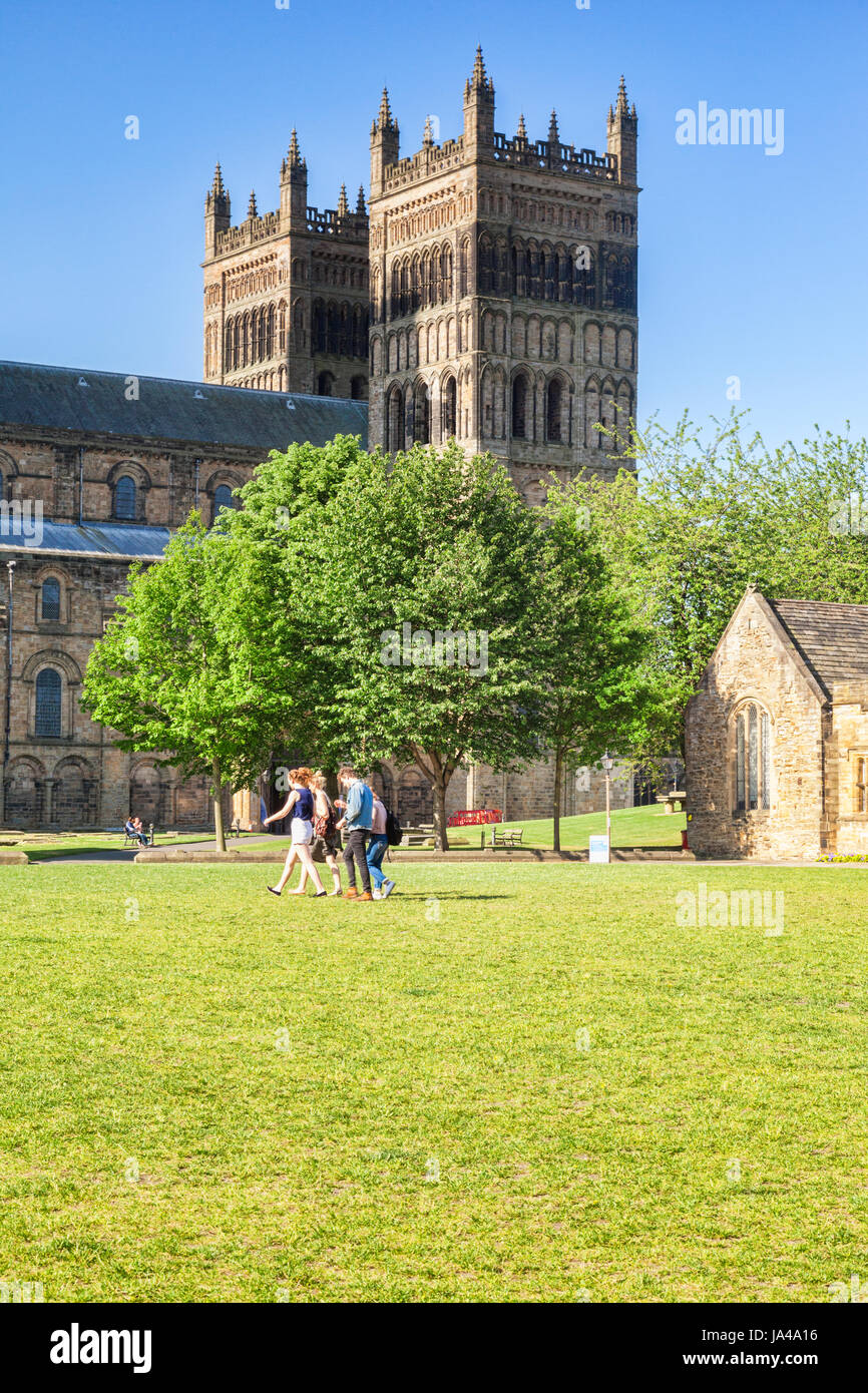 25 May 2017: Durham City, England, UK - Students crossing Palace Green, with the Cathedral in the background. - Stock Image