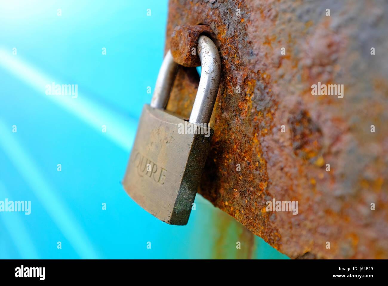 brass locked padlock on beach hut - Stock Image