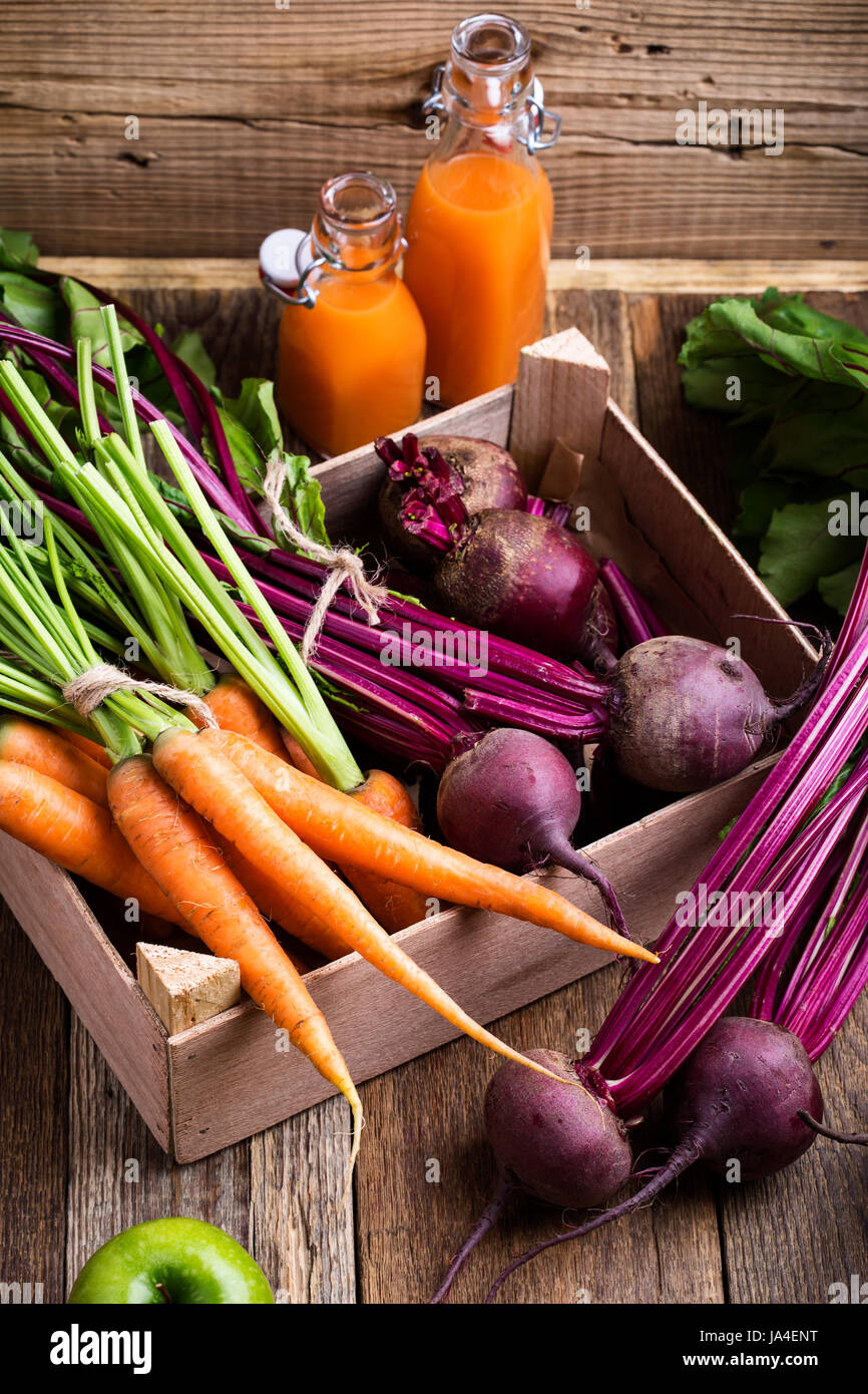 Organic  farm. Fresh vegetables in crate,   beetroots and  carrots on rustic wooden background Stock Photo