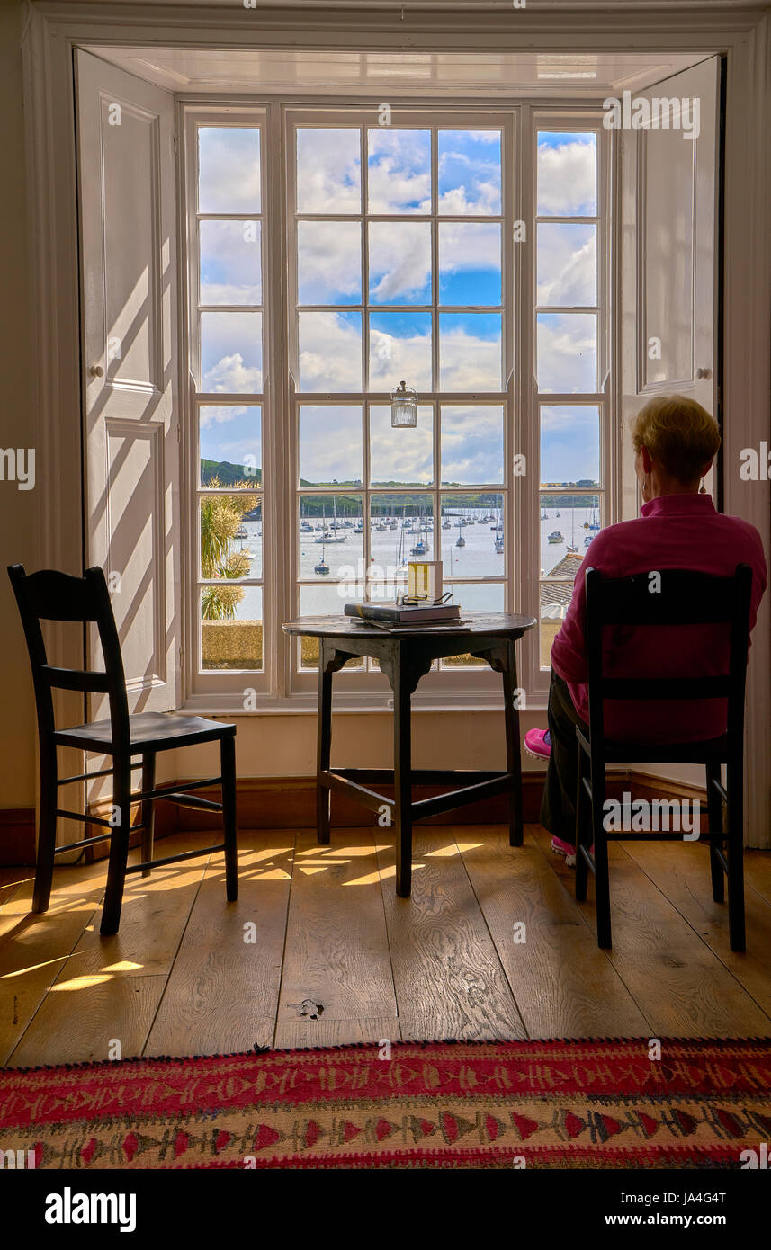 Cool A Woman Sitting On A Chair Inside A Cottage Looking Out Squirreltailoven Fun Painted Chair Ideas Images Squirreltailovenorg