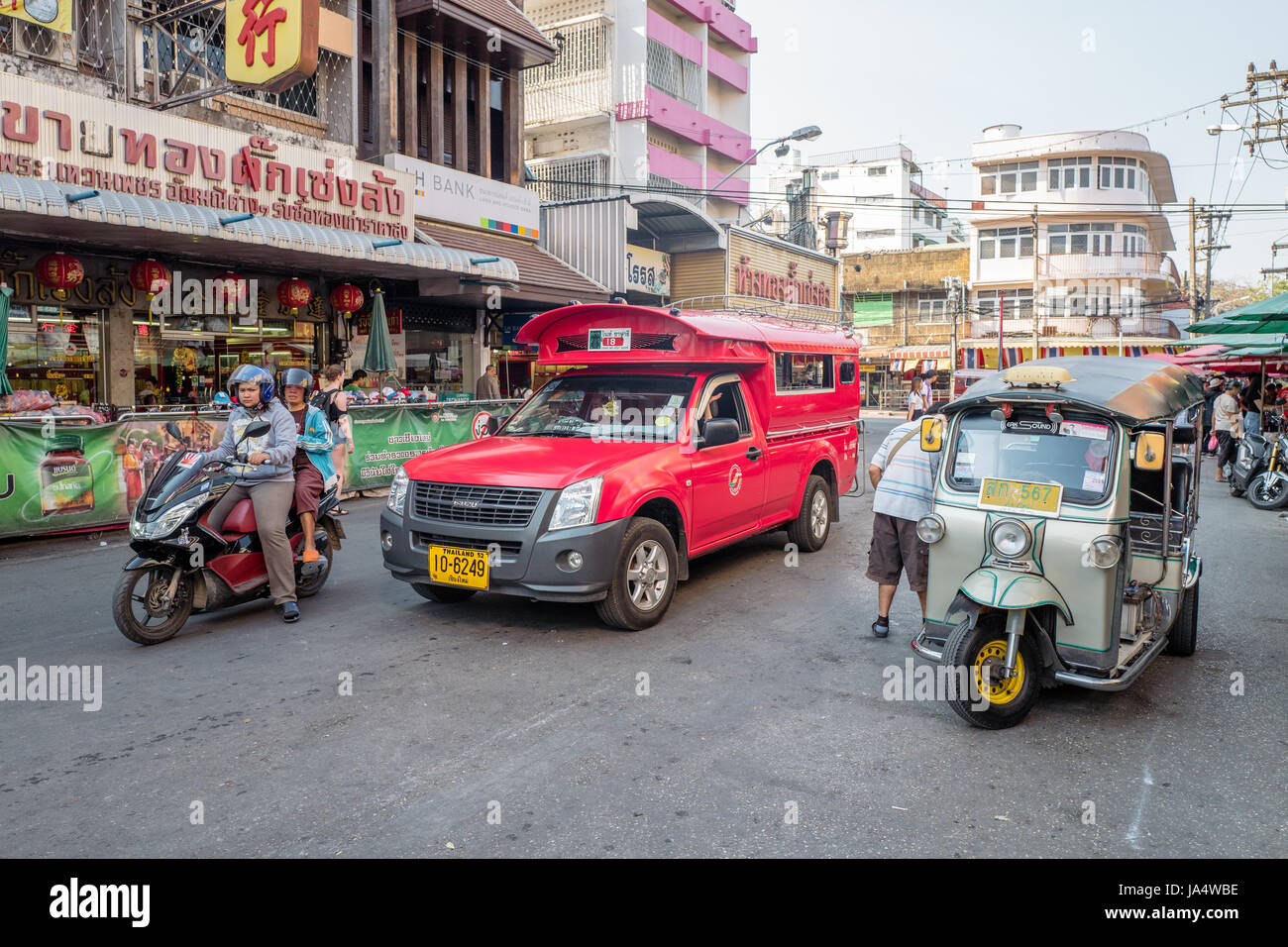 Traditional red songthaew taxi outisde Warorot market in Chiang Mai. This is the largest city in northern Thailand. - Stock Image